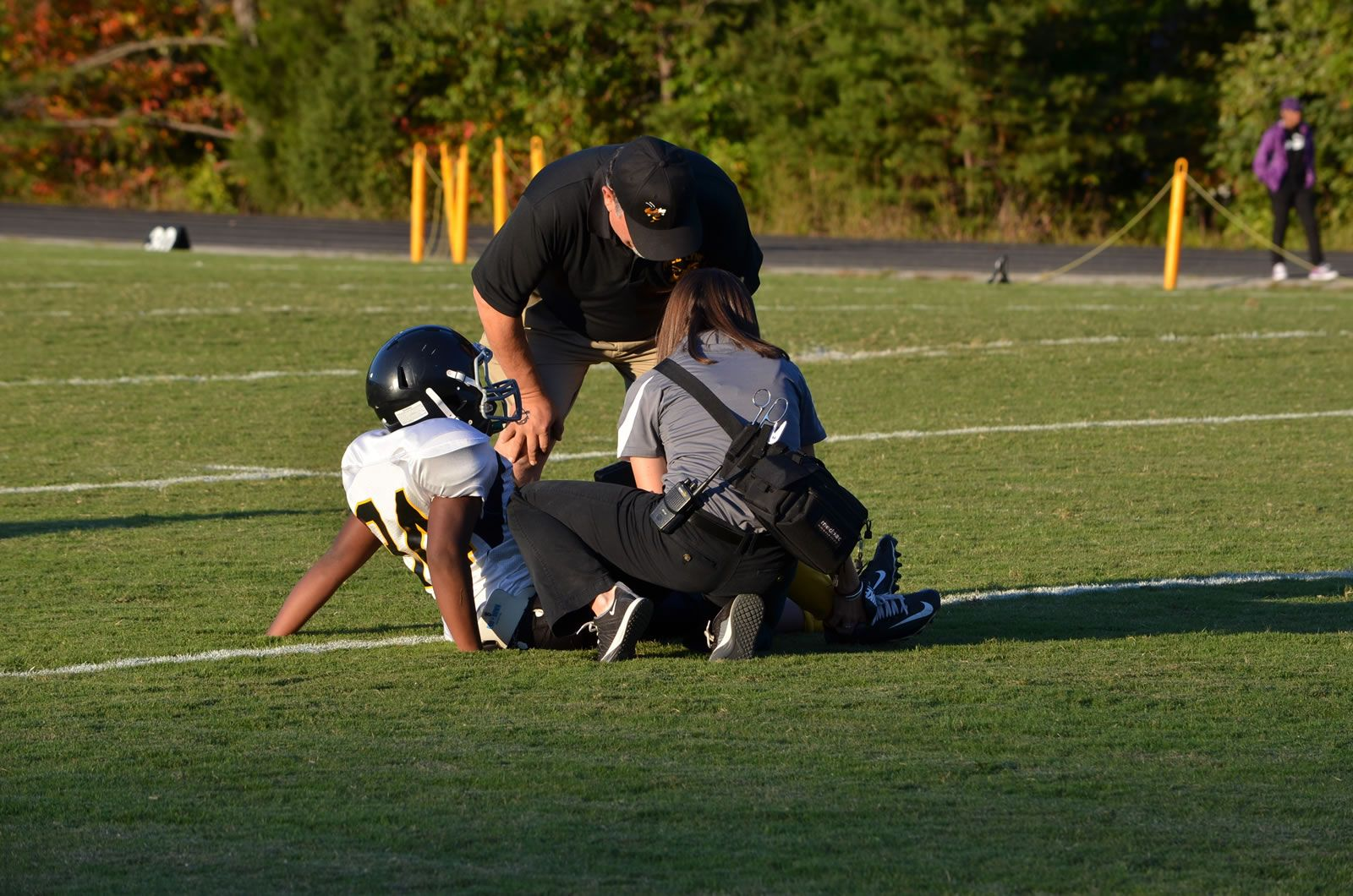 Kaitlin Romm works as Athletic Trainer on football field