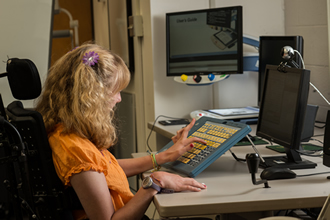 Student using assistive technology keyboard